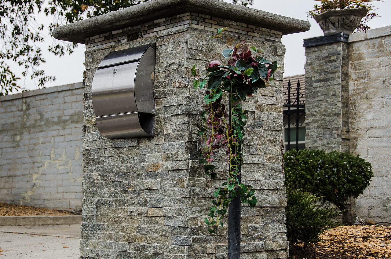 A vault-like mailbox for a securely gated home